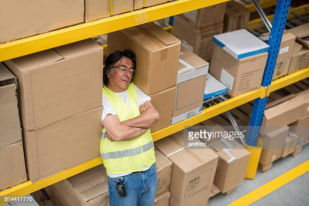 Lazy worker sleeping at a warehouse