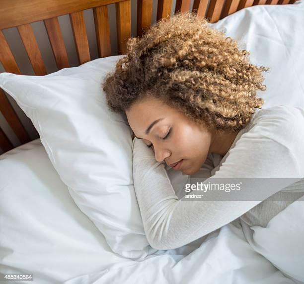 Lazy young woman sleeping in bed