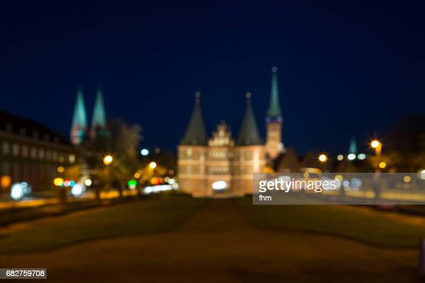Lübeck, defocused Holstentor at night (Schleswig-Holstein, Germany)