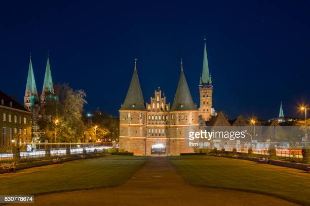 Lübeck, Holstentor at blue hour panorama (Schleswig-Holstein, Germany)