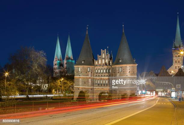 Lübeck, Holstentor at blue hour with vehicle lights (Schleswig-Holstein, Germany)