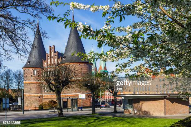 Lübeck, Holstentor - with cherry blossoms (Schleswig-Holstein, Germany)