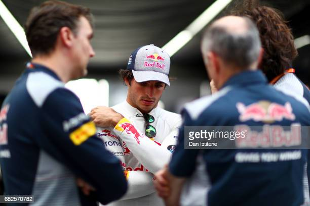 lCarlos Sainz of Spain and Scuderia Toro Rosso talks with his race engineer Marco Matassa Scuderia Toro Rosso Team Principal Franz Tost and James Key...