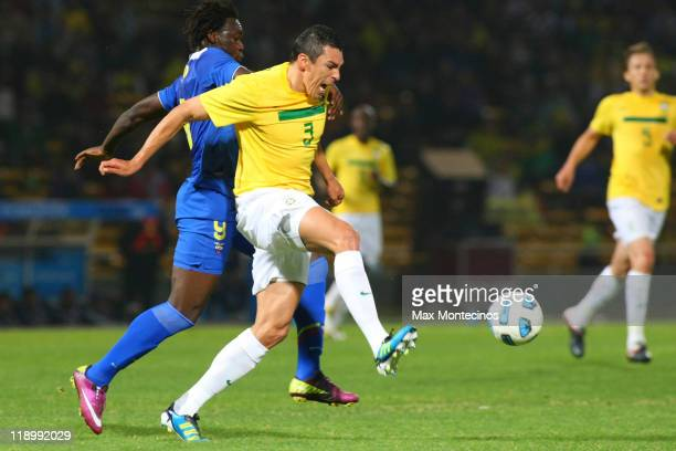 Lúcio from Brazil fights for the ball with Felipe Caicedo from Ecuador during a match between Brazil and Ecuador as part of the Group B of the Copa...