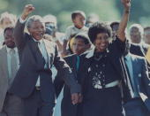 ANC ldr Nelson Mandela and wife Winnie raising fists upon his release from Victor Verster prison after 27 yrs