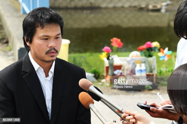 Le Anh Hao the father of 9yearold Vietnamese girl Le Thi Nhat Linh who was allegedly murdered by a neighbor speaks to reporters in Abiko near Tokyo...