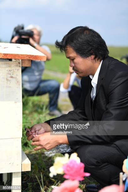 Le Anh Hao the father of 9yearold Vietnamese girl Le Thi Nhat Linh who was allegedly murdered by a neighbor visits on Sept 26 the site where her body...