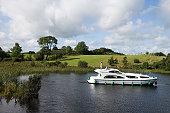 Le Boat Emerald Star Elegance houseboat on River Shannon with green of Carrick Golf Course.