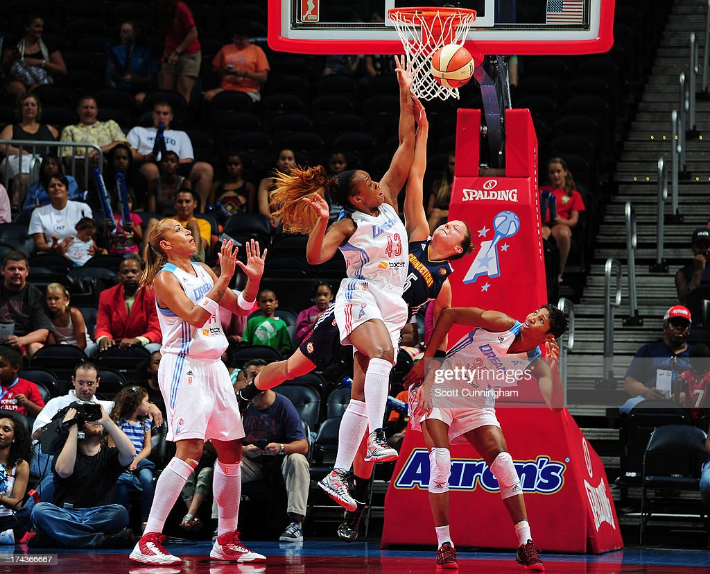 Le 'Coe Willingham #43 of the Atlanta Dream battles for a rebound against Kelsey Griffin #5 of the Connecticut Sun at Philips Arena on July 24, 2013 in Atlanta, Georgia.