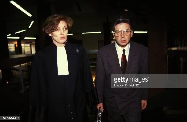 Le docteur Jacques L'Hermite arrive avec son avocate au tribunal afin d'etre juge pour extorsion de fonds dans l'exercice de sa profession le 15...
