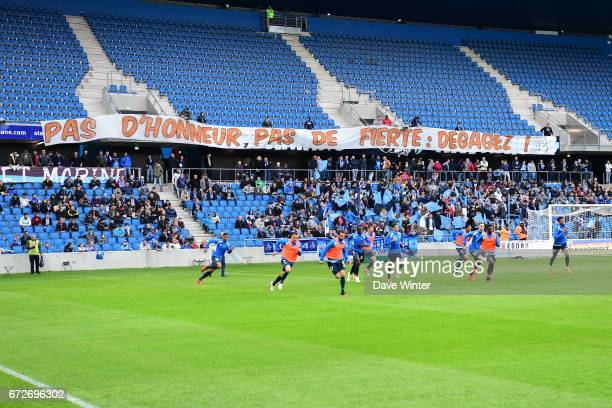 Le Havre supporters display a banner demanding their players to put in more effort before the Ligue 2 match between Le Havre AC and Racing Club de...