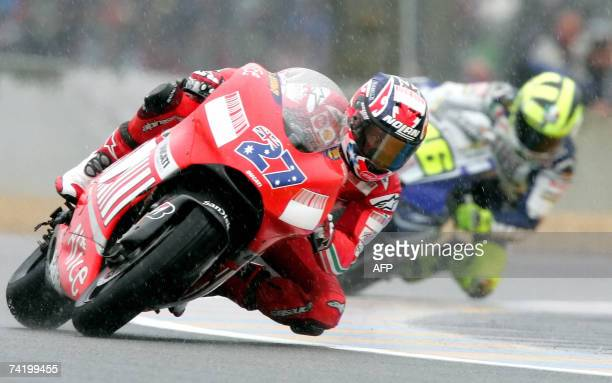 Australian MotoGP rider Casey Stoner races ahead of Italian Valentino Rossi during the French Grand Prix 20 May 2007 on Le Mans racetrack Australian...