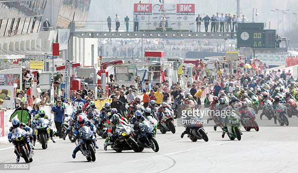 Fifty six riders steer their bikes 22 April 2006 at the beginning of the 29th edition of the 24hour motorcycling endurance race at the Bugatti...