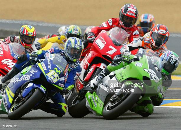 The pack rides during the MotoGP French Grand Prix 15 May 2005 in Le Mans Italy's Valentino Rossi won the race AFP PHOTO VALERY HACHE
