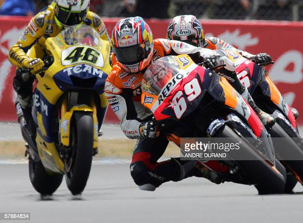 US Nicky Hayden rides his Honda ahead of Italian Valentino Rossi during the trial session of the MotoGP category at the French motorcycling Grand...
