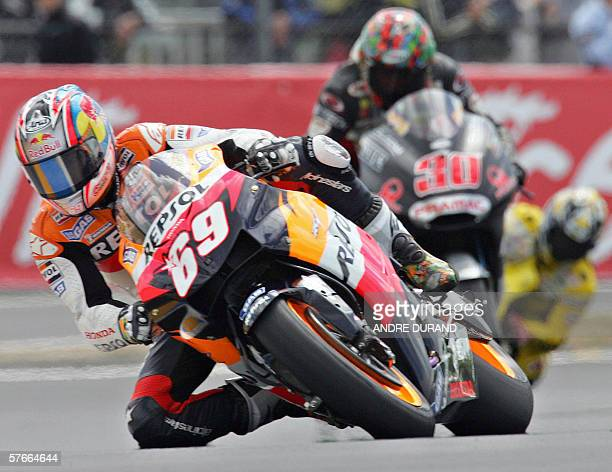 US Nicky Hayden rides his Honda ahead of Spaniard Jose Luis Cardosa during the trial session of the MotoGP category at the French motorcycling Grand...