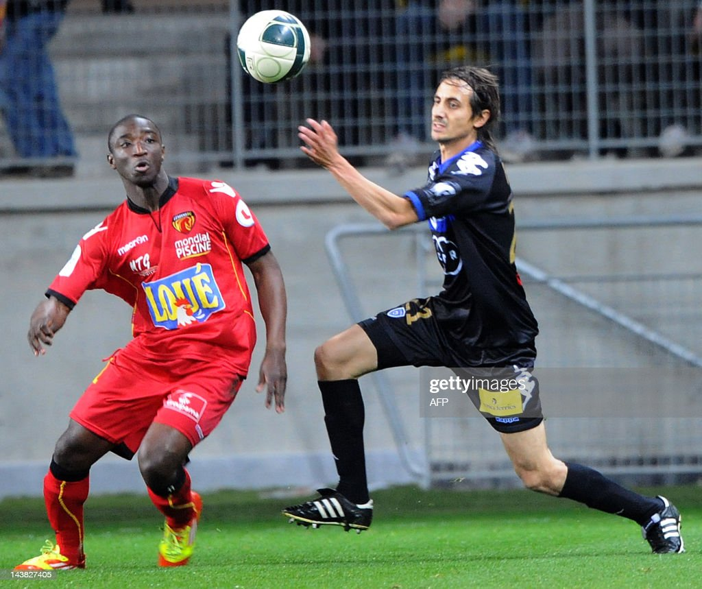 Le Mans' French midfielder Antony Koura (L) vies with Bastia's French defender Fethi Harek (R) during the French L2 football match Le Mans vs. Bastia on May 4, 2012 at the Le Mans Stadium in Le Mans, western France. Le Mans won 3-0.