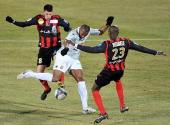 Le Mans' midfielder Herold Goulon vies with Boulogne's defender Bira Dembele and midfielder Johann Ramare during the French L1 football match...
