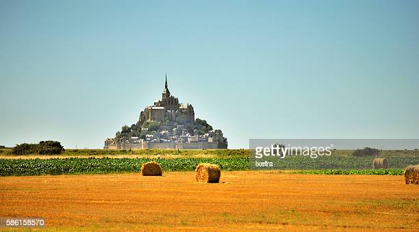Le Mont-Saint-Michel, straw bales, fields or Normandy.