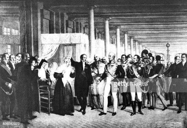 Le roi Charles X visitant une femme opérée de la cataracte par le chirurgien Guillaume Dupuytren à l'HôtelDieu de Paris en France