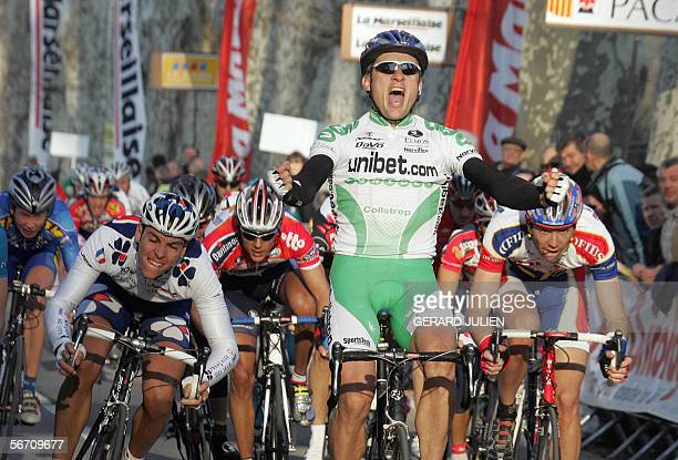 Australian cyclist Baden Cooke jubilates as he crosses the finish line of the prolog of the 36th edition of the Etoile de Besseges 'Grand Prix La...
