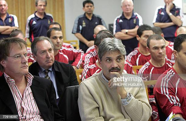 Paris' coach Guy Lacombe and Lyon's coach Gerard Houllier and Daniel Jeandupeux Le Mans' football manager attend a meeting gathering L1 football...