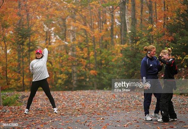 PLACID NY OCTOBER 11 Lea Ann Parsley member of the USA Olympic Skeleton Team streches while two of her teammates Lyndsie Peterson and Amanda Bird...