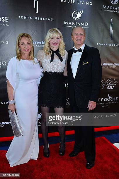Lea Black Courtney Love and Roy Black attend The Blacks Annual Gala at Fontainebleau Miami Beach on October 25 2014 in Miami Beach Florida