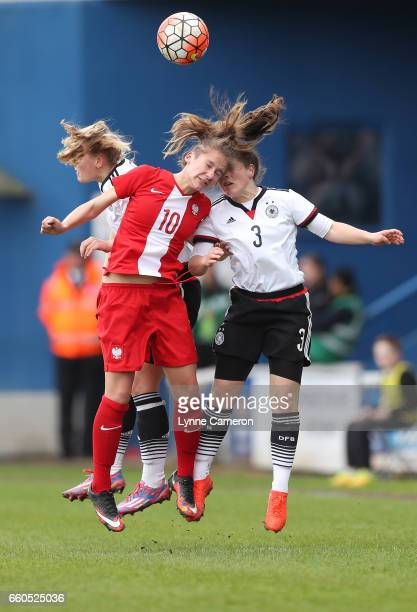 Lea Hahnemann and Sydney Lohmann of Germany jump for a ball with Paulina Filipczak of Poland during the UEFA U17 Women's Championship Qualifier match...