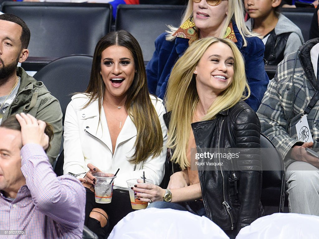 Lea Michele and Becca Tobin attend a basketball game between the New York Knicks and the Los Angeles Clippers at Staples Center on March 11 2016 in...