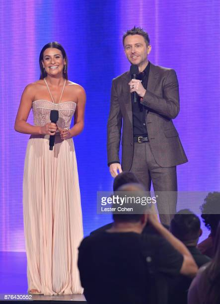 Lea Michele and Chris Hardwick speak onstage during the 2017 American Music Awards at Microsoft Theater on November 19 2017 in Los Angeles California