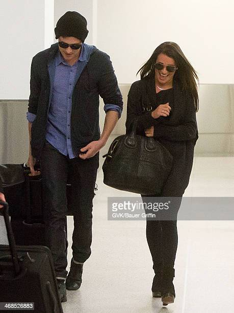Lea Michele and Cory Monteith are seen at Los Angeles International Airport on March 19 2013 in Los Angeles California