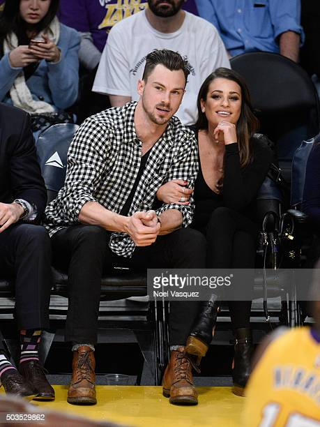 Lea Michele and Matthew Paetz attend a basketball game between the Golden State Warriors and the Los Angeles Lakers at Staples Center on January 5...