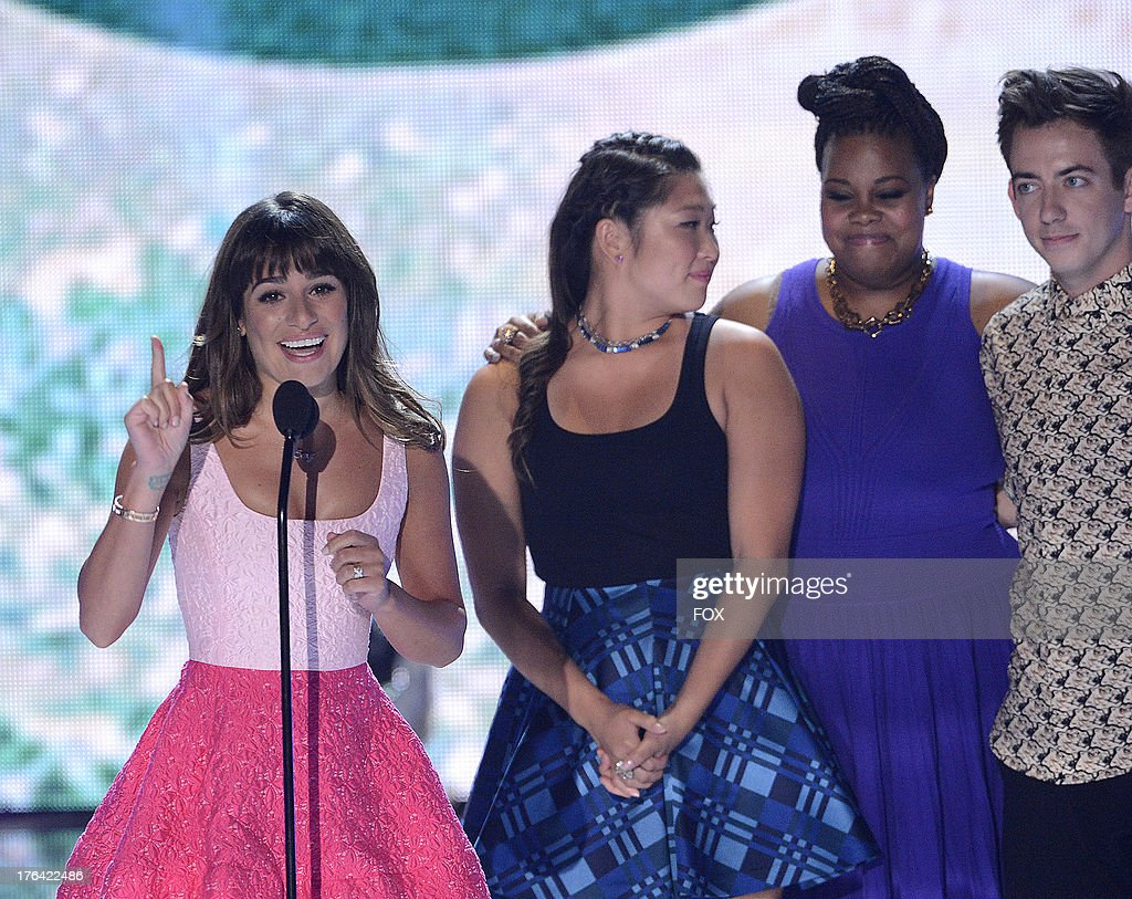 Lea Michele, Jenna Ushkowitz, Amber Riley and Kevin McHale speak onstage at the 2013 Teen Choice Awards at Gibson Amphitheater on August 11, 2013 in Universal City, California.