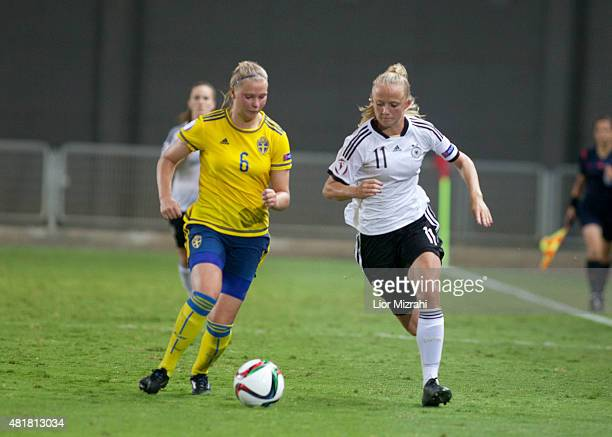 Lea Schuller of Germany challenges Ellen Lofqvist of Sweden during the UEFA Women's Under19 European Championship semi final between U19 Germany and...