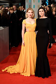 Lea Seydoux and Monica Bellucci attend the EE British Academy Film Awards at The Royal Opera House on February 8 2015 in London England