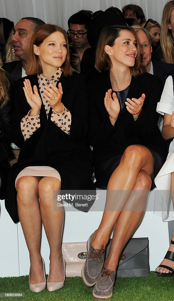 Lea Seydoux and Rebecca Hall attend the Mulberry Spring/Summer 2014 show during London Fashion Week at Claridges Hotel on September 15 2013 in London...