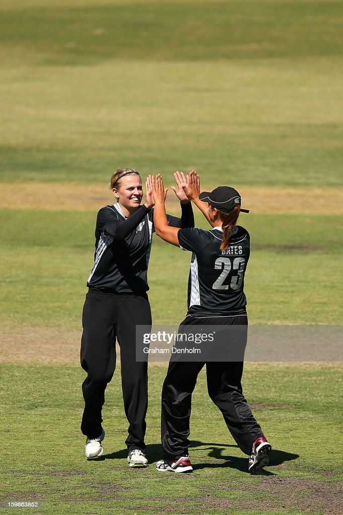 Lea Tahuhu of New Zealand (L) and Suzie Bates of New Zealand celebrate after Tahuhu bowled and Bates caught out Jess Cameron of Australia during the Women's International Twenty20 match between the Australian Southern Stars and New Zealand at Junction Oval on January 22, 2013 in Melbourne, Australia.