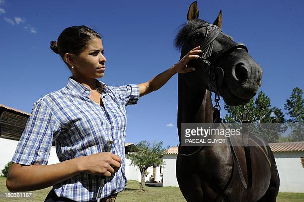 Lea Vicens a French 'rejoneadora' who takes part in bullfighting on horseback poses for a photograph during a training session in Nimes on September...