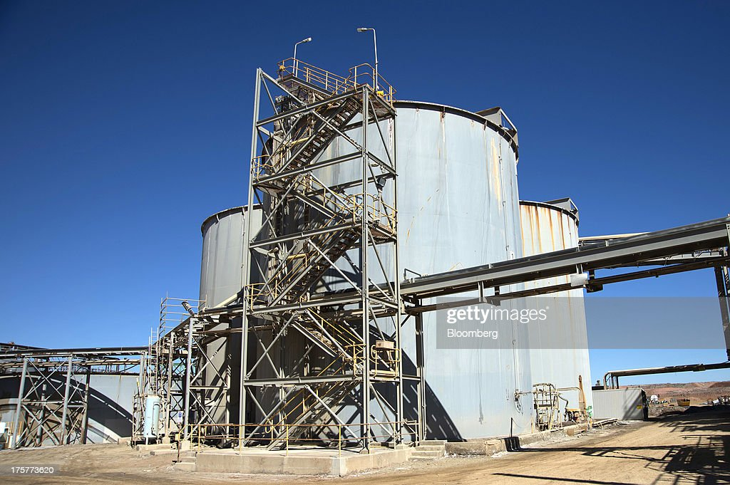 Leaching tanks stand at the Norton Gold Fields Ltd. Paddington operations 35 kilometers north-west of Kalgoorlie, Australia, on Wednesday, Aug. 7, 2013. Norton, the Australian producer controlled by China's Zijin Mining Group Co., is seeking further acquisition targets as falling prices cut the value of mines. Photographer: Carla Gottgens/Bloomberg via Getty Images