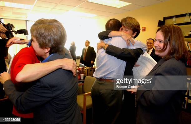Lead attorney Mary L Bonauto on left hugs plaintiff Ellen Wade from Newton Staff attorney Karen Loewy on the right In the middle plaintiff Hillary...