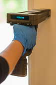 Inspection of lead-based paint (LBP) using an XRF analyzer.  The analyzer is used by an inspector to test for lead in paint to protect children from lead poisoning.