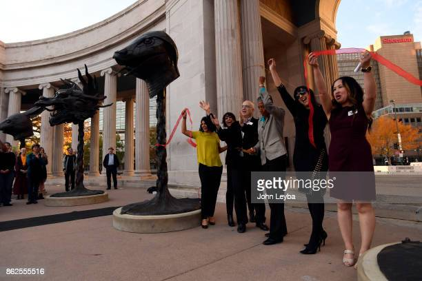 Lead by Happy Haynes Deputy Mayor of Denver the Denver Arts Venues celebrates the arrival of Ai Weiweis Circle of Animals/Zodiac Heads with a ribbon...