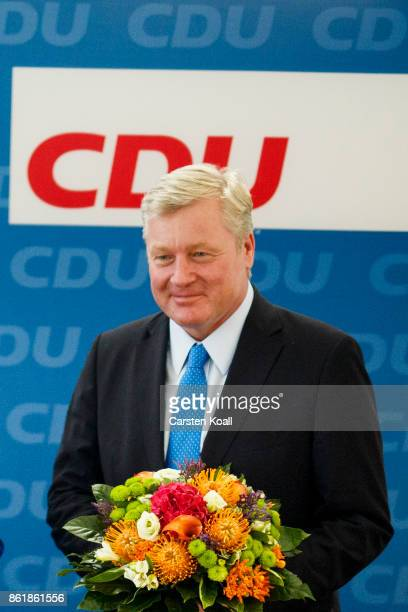 CDU lead candidate in yesterday's state elections in Lower Saxony Bernd Althusmann holds flowers as he attends the meeting of the CDU board on...
