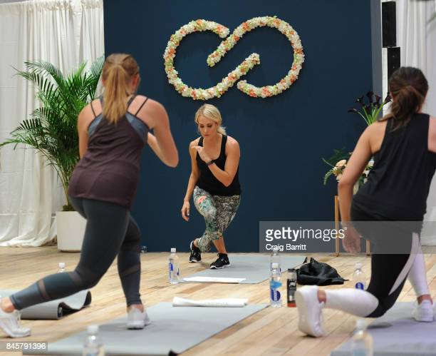 CALIA lead designer Carrie Underwood and her road trainer Eve Overland lead a group workout to celebrate the line's Fall/Winter 17 collection at West...