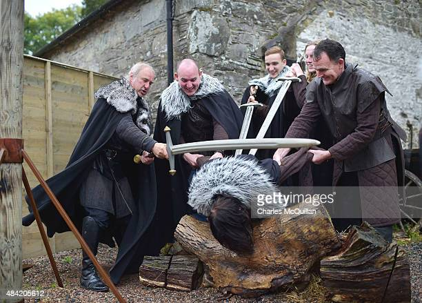Lead Game of Thrones tour instructor William Kells 'beheads' a tourist as part of the Winterfell experience at Castle Ward on August 13 2015 in...