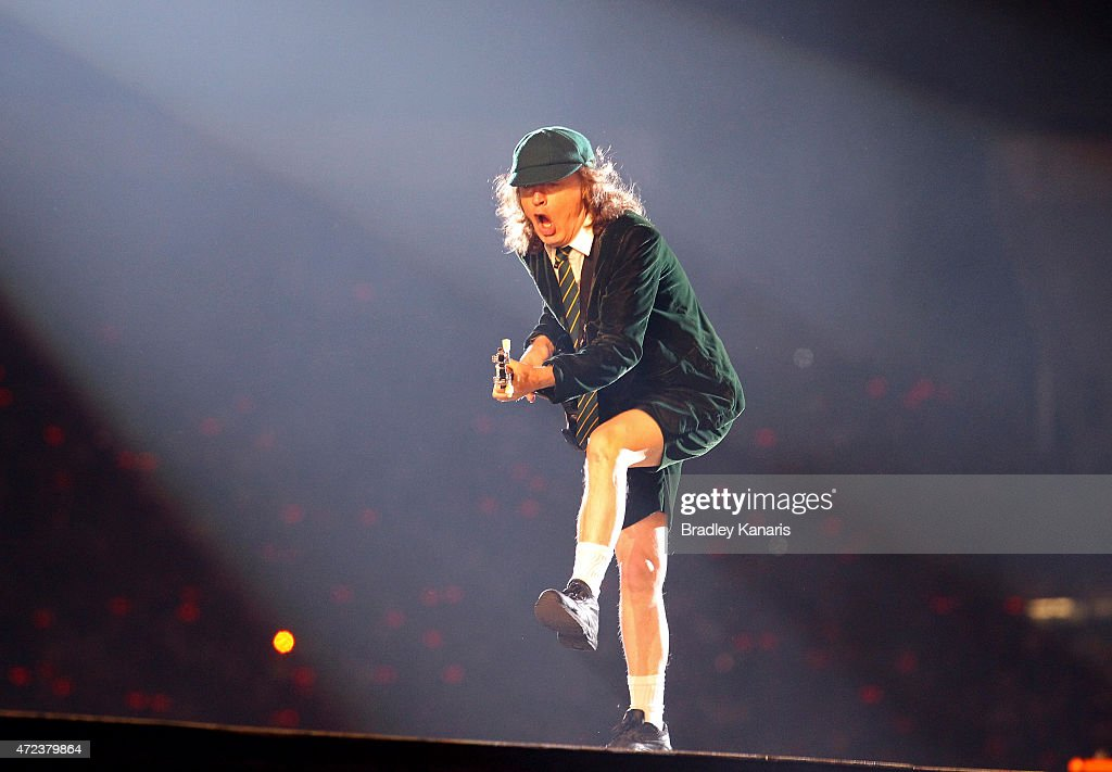 Lead guitarist Angus Young does his famous duck walk as AC/DC perform live for fans at Queensland Sport and Athletics Centre on February 25, 2010 in Brisbane, Australia.