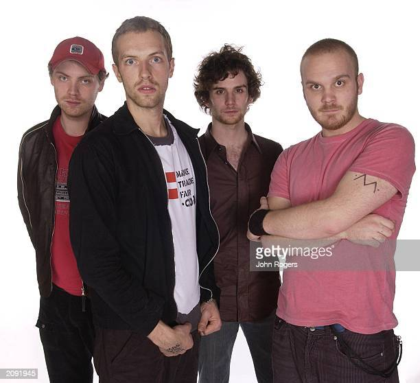 Lead guitarist Jon Buckland lead singer Chris Martin bassist Guy Berryman and drummer Will Champion from the British rock band 'Coldplay' pose for an...