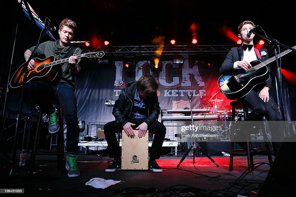 Lead guitarist Nash Overstreet, percussionist Jamie Follese, and lead vocalist Ryan Follese of Hot Chelle Rae perform onstage at The 3rd Annual Salvation Army Rock The Red Kettle Concert at Nokia Theatre L.A. Live on December 15, 2012 in Los Angeles, California.