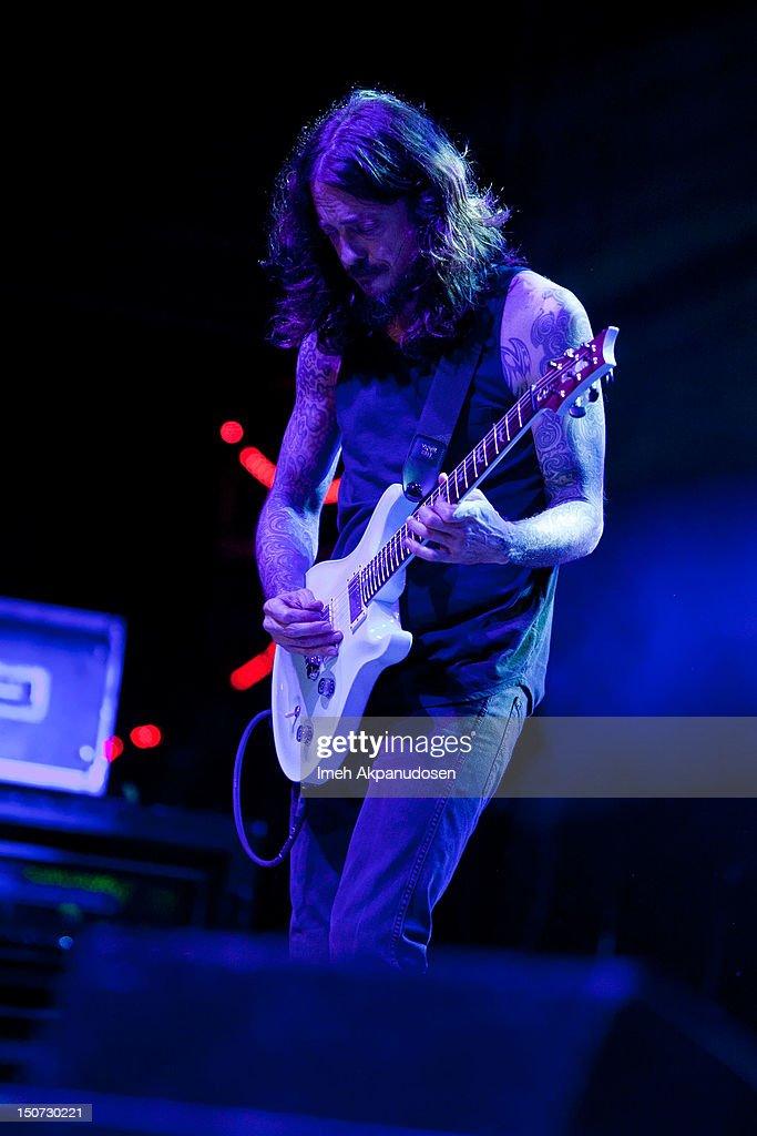 Lead guitarist Tim Mahoney of 311 performs onstage at Verizon Wireless Amphitheatre on August 24, 2012 in Laguna Hills, California.